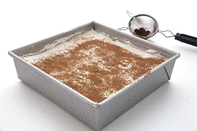 Creamy chocolate layered dessert in a square pan