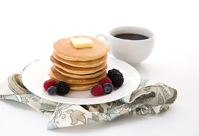 Easy keto pancakes in a stack with butter and coffee