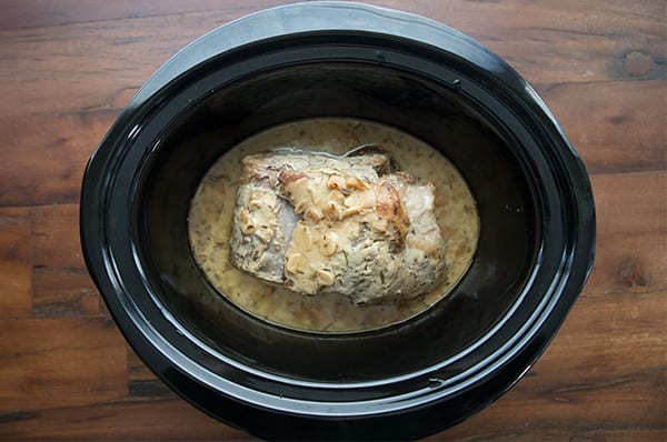 Pork loin cooked in a crockpot with garlic and herbs