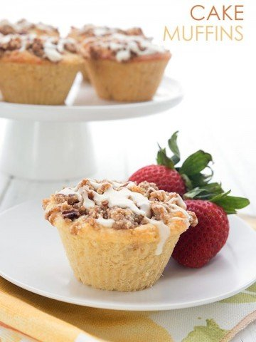 Keto coffee cake muffins on a white plate with strawberries.