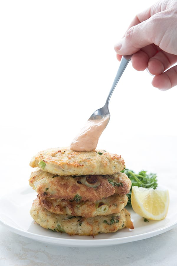 A dollop of spicy mayo on keto crab cakes