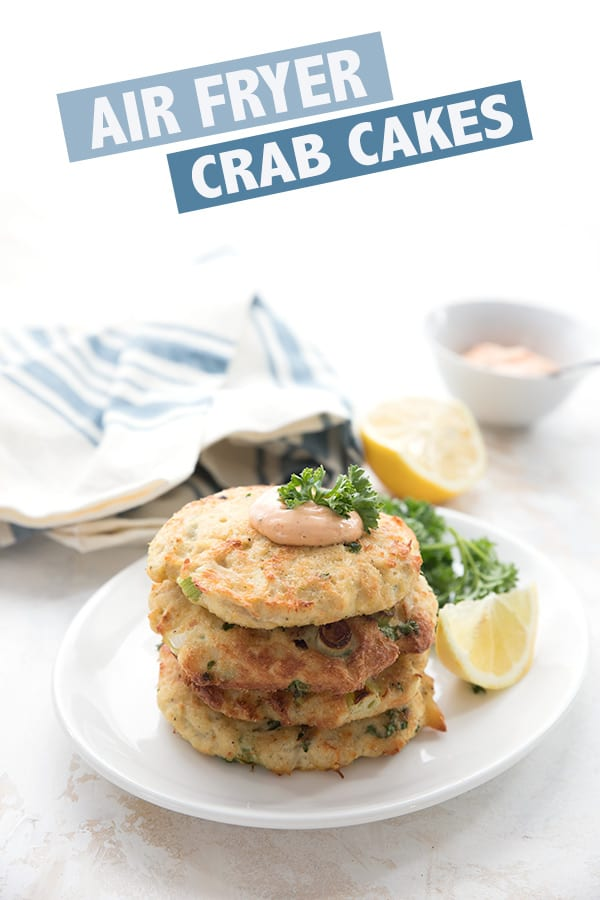 Air Fryer Crab Cakes in a stack on a white plate