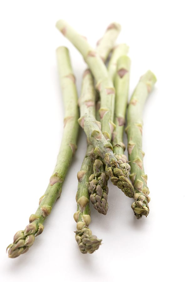 Stalks of asparagus on a white background