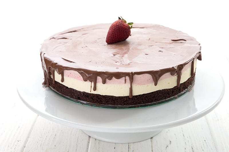 Keto Neapolitan Ice Cream Cake on a white cake stand