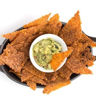 Top down photo of low carb tortilla chips with guacamole