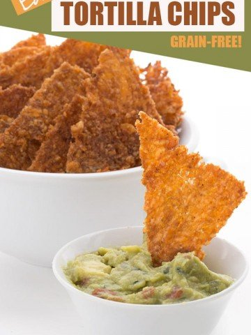 Keto friendly tortilla chips being dipped into guacamole
