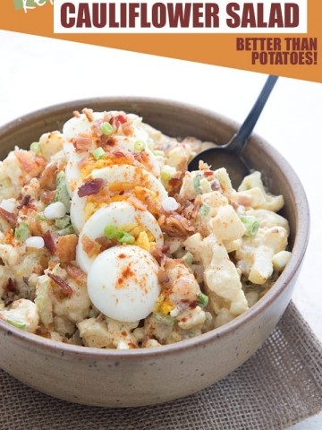 Creamy Cauliflower Salad in a brown bowl with a serving spoon