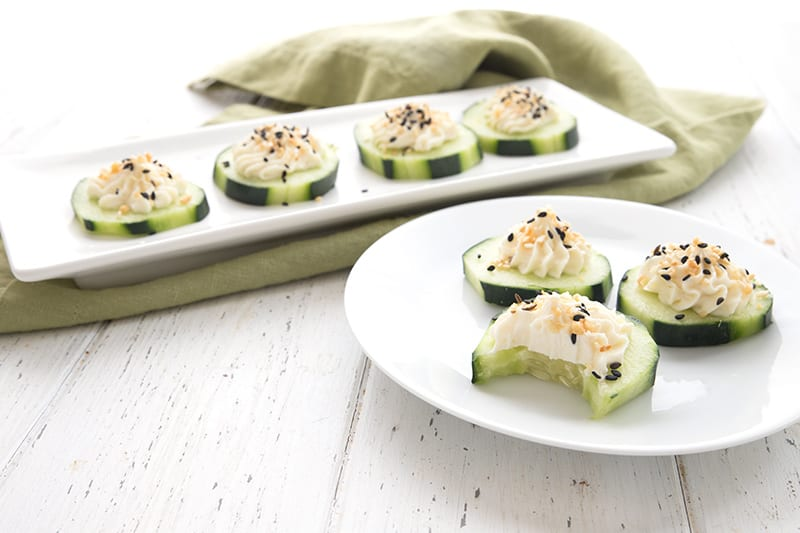 Little cucumber cream cheese appetizers on a plate