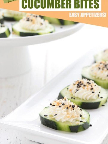 Cucumber appetizers with cream cheese and everything bagel seasoning on a tray