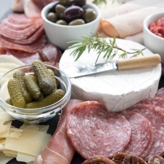 Keto appetizers tray with meats, cheeses and salted pecans