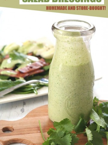 Keto creamy cilantro salad dressing in a glass jar with salad in the background