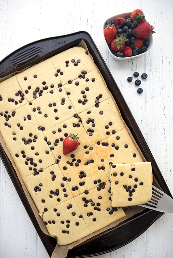 Top down photo of baked pancakes in a sheet pan with chocolate chips
