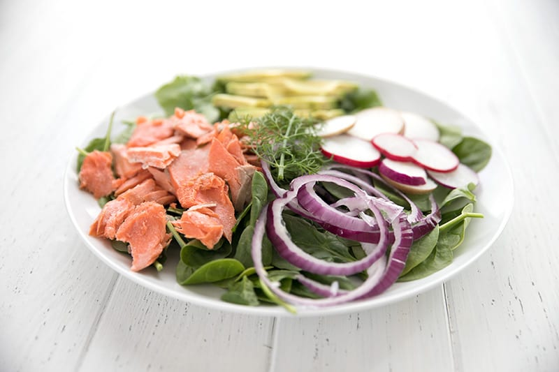 Keto salmon salad with spinach, avocado and creamy dill dressing