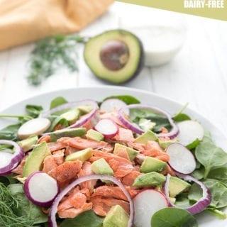 Salmon avocado salad on a white platter