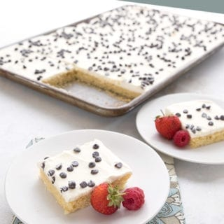 Cannoli sheet cake with slices on white plates in front
