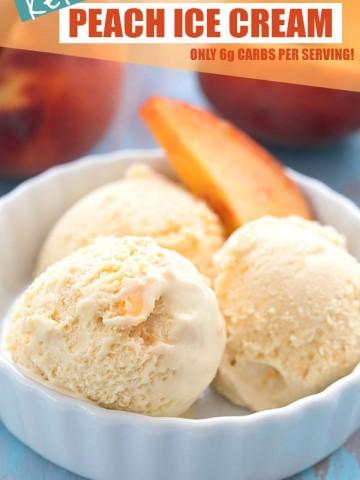 Keto peach ice cream in a white bowl with a slice of peach