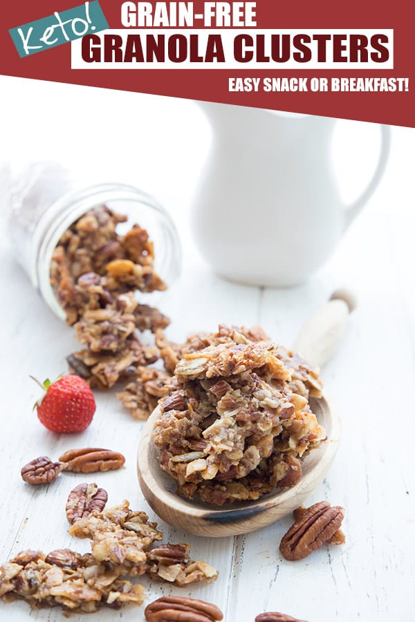 Large clusters of grain-free keto granola in a wooden scoop on a white table