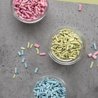 Homemade sugar free sprinkles in little glass bowls on a concrete surface