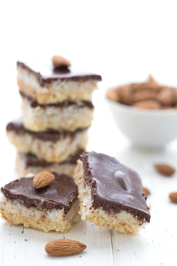 A stack of keto dairy-free Almond Joy Bars on a white table.