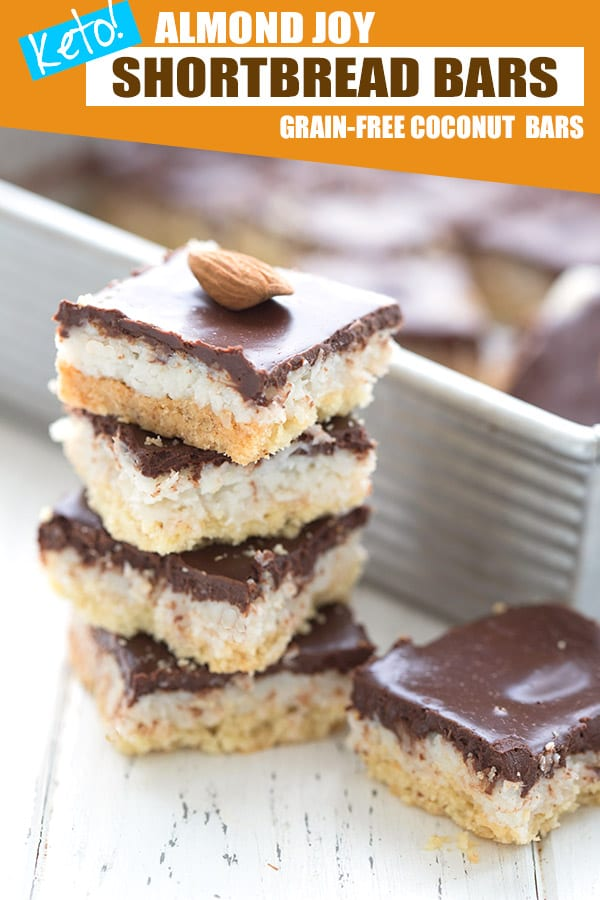Keto Almond Joy Bars in a stack with the pan of bars in the background