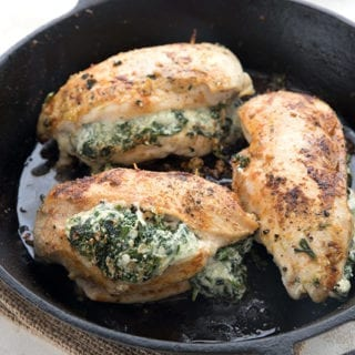 Close up of keto stuffed chicken breast in a cast iron skillet.
