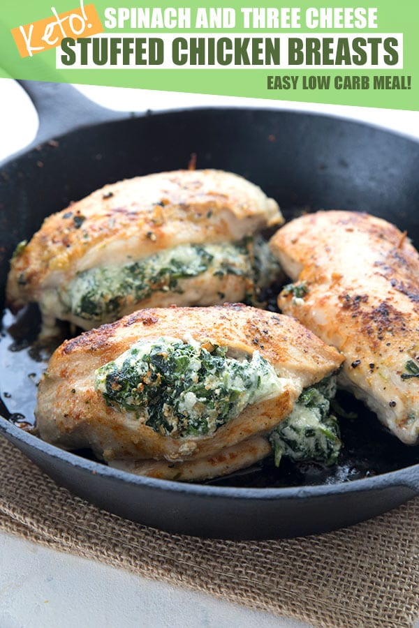 Keto stuffed chicken breasts in a cast iron pan. Stuffed with spinach and cheese.
