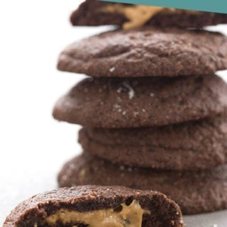 Keto chocolate cookies with a delicious peanut butter filling oozing out.