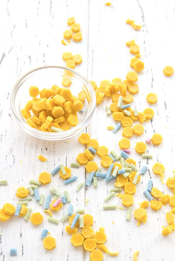 Yellow sugar free sprinkles on a white tabletop