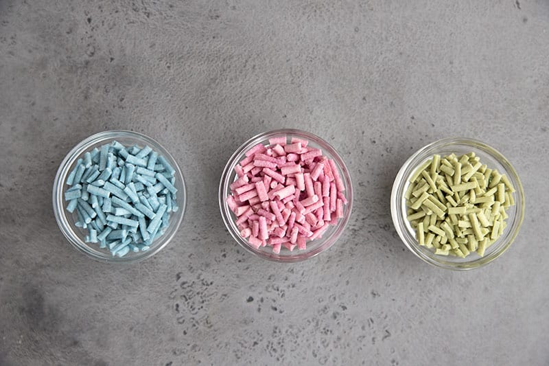 Blue, pink, and green sugar free sprinkles in little glass bowls