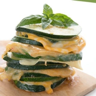 Zucchini grilled cheese sandwiches in a stack on a wooden cutting board