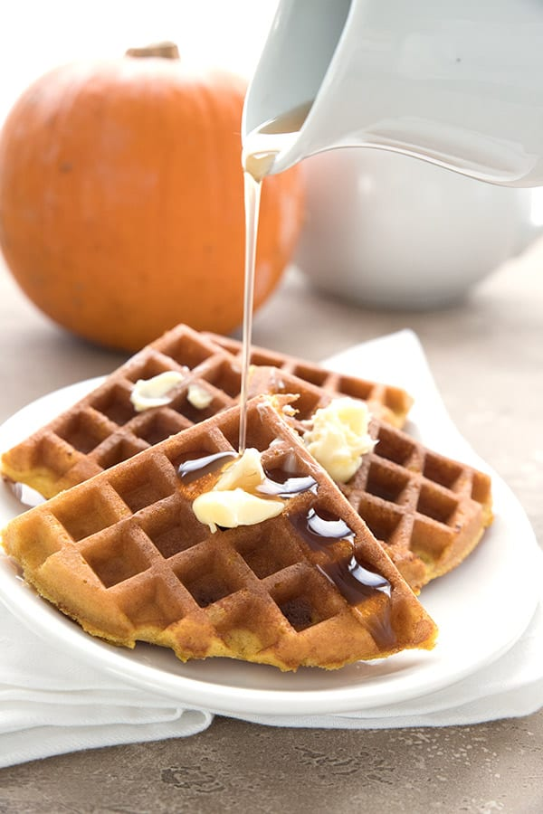 Syrup pouring over keto pumpkin spice waffles