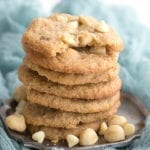 A stack of chew keto cookies on a pewter plate with a gauzy teal napkin