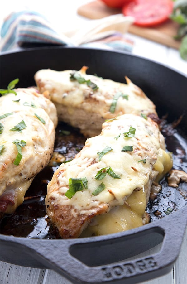 Stuffed chicken breast in a cast iron pan