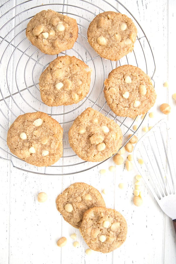 Top down photo of keto white chocolate macadamia nut cookies on a cooling rack