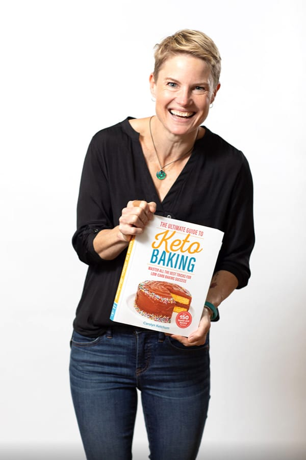 The author holding a copy of The Ultimate Guide to Keto Baking