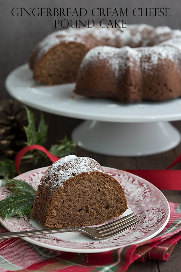 A slice of keto gingerbread pound cake on a red patterned plate over a plaid holiday napkin.