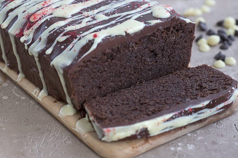 A slice of chocolate peppermint pound cake with dark chocolate and white chocolate chips.