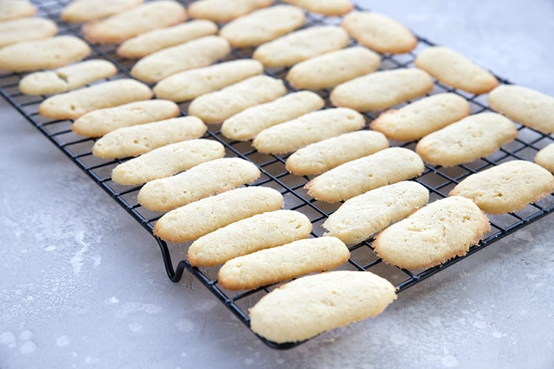 Light keto butter cookies on a cooling rack, to make keto milanos.