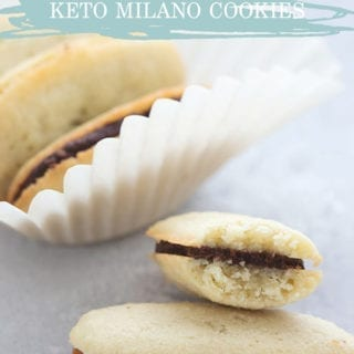 Title image of homemade keto milano cookies in a pile, and one has a bite taken out of it.