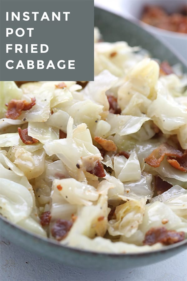 Close up shot of keto fried cabbage with bacon in a green serving dish.