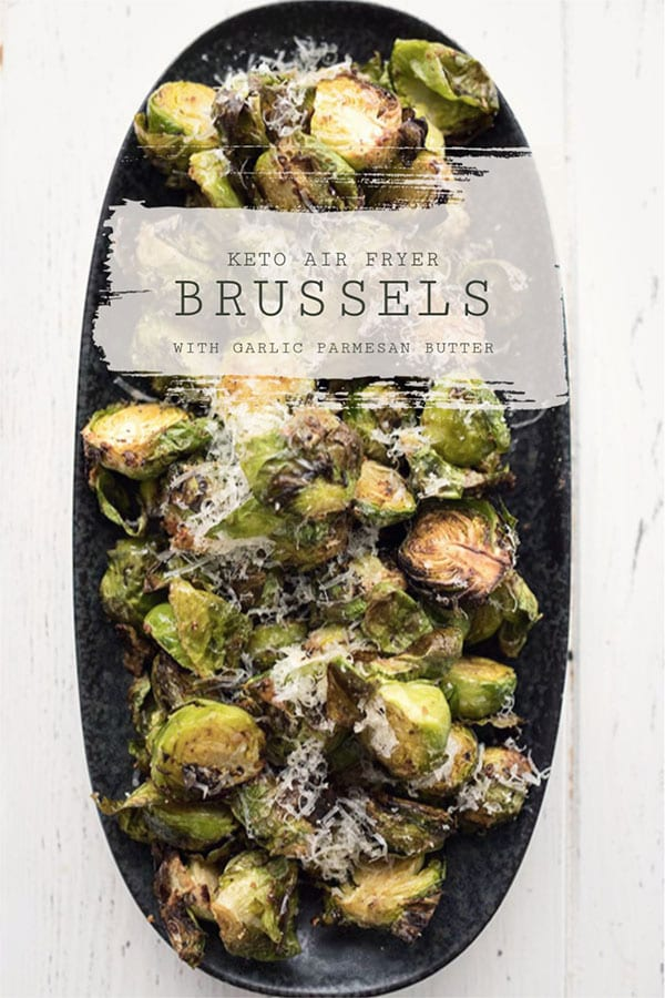 Top down photo of air fryer Brussels sprouts in a black serving dish.