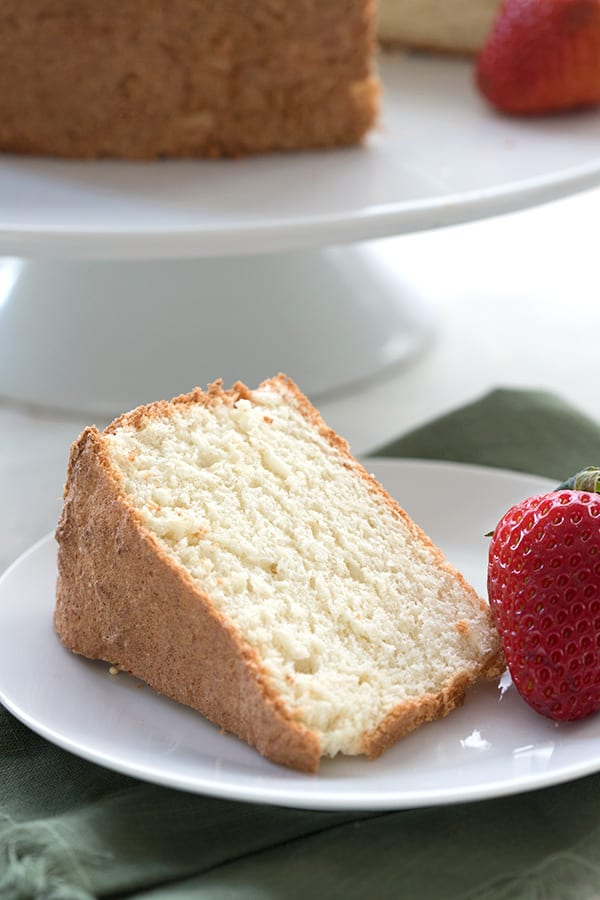 Close up of a slice of keto angel food cake.