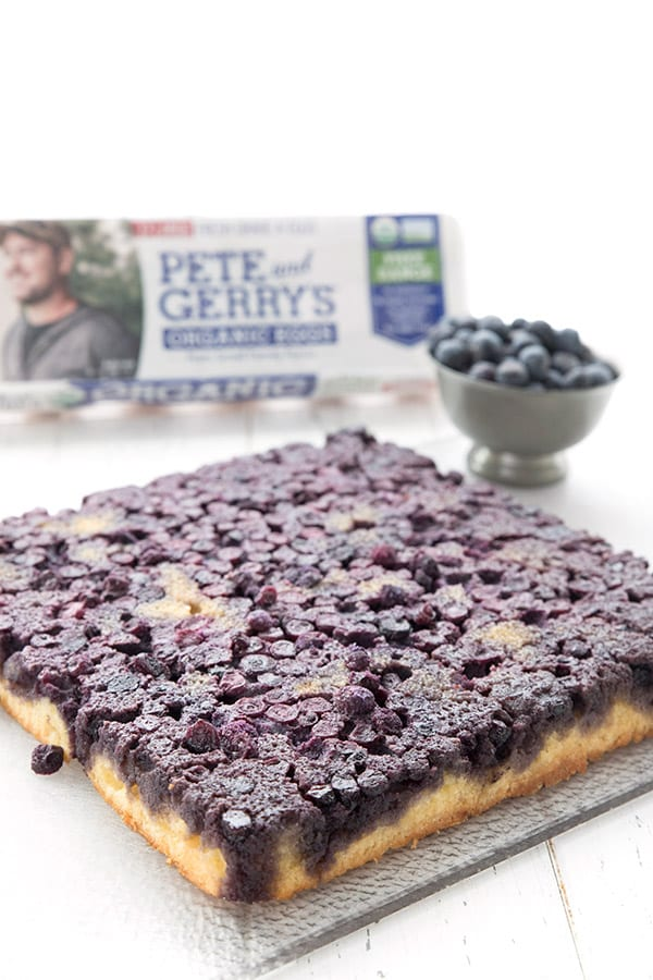 A square keto blueberry upside down cake on a white table.