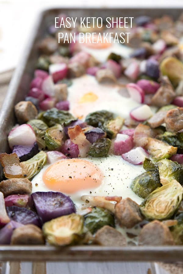 Close up of keto sheet pan breakfast with veggies, eggs, bacon and sausage