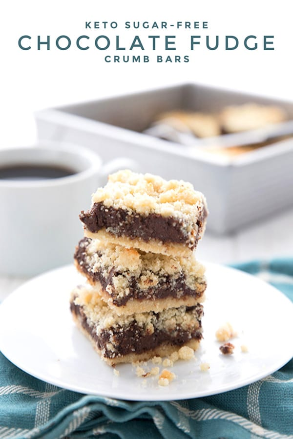 Titled image of a stack of keto fudge crumb bars on a white plate over a teal plaid napkin
