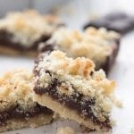 Close up shot of keto fudge crumb bars on a white table