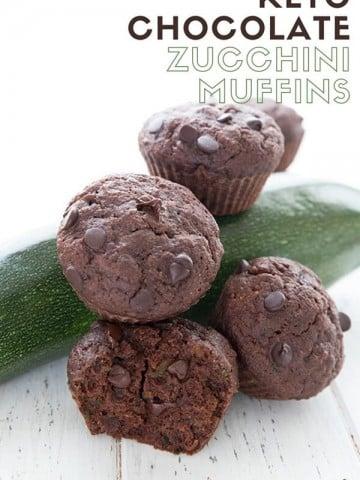 Titled image of chocolate zucchini muffins piled around a zucchini