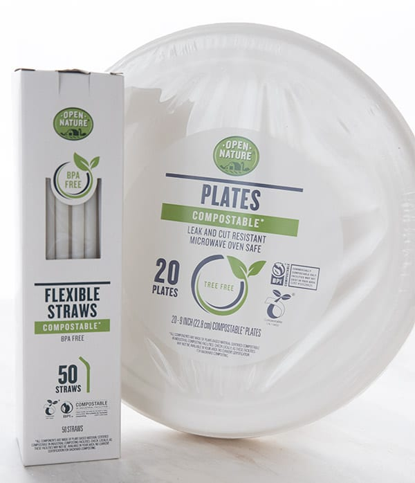 Open Nature compostable plates and straws on a white background.