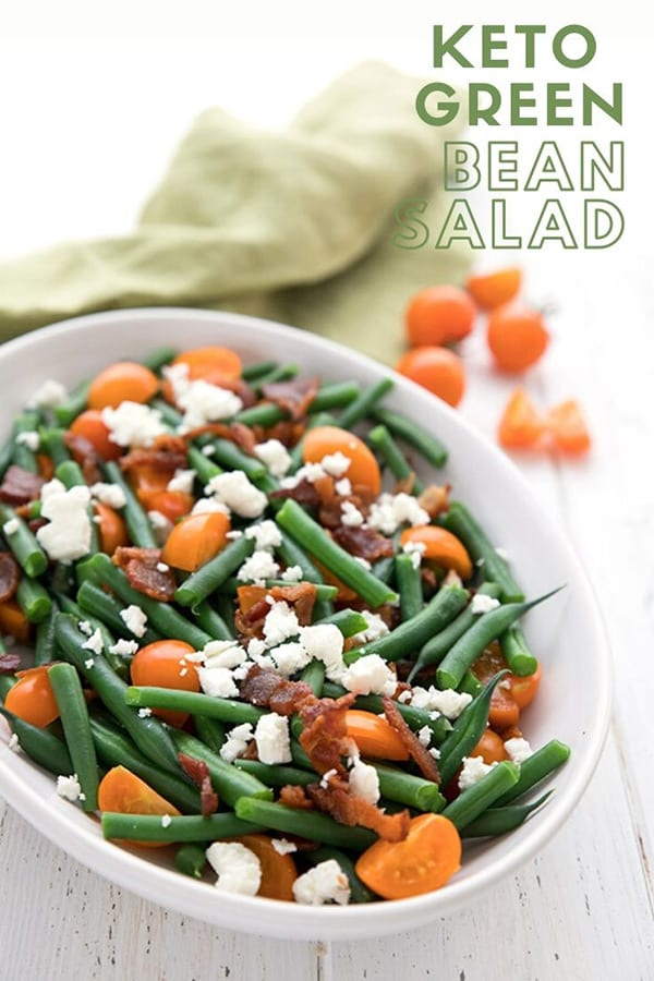 Titled image of Green Bean Salad with bacon, tomatoes and feta in a white oval dish