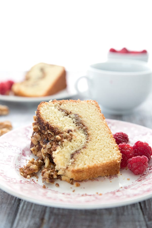 Keto Diet Explained  A slice of cinnamon walnut coffee cake on a red patterned plate, close up.